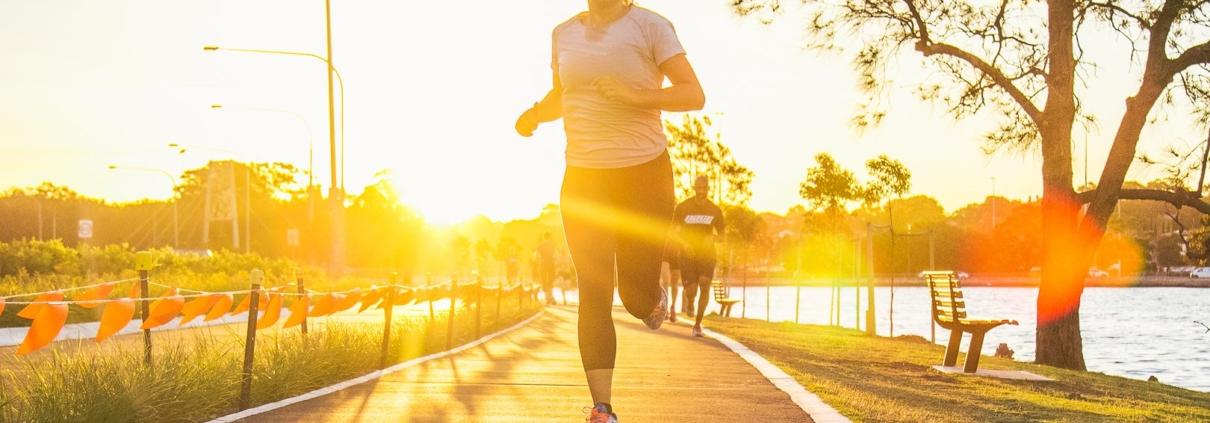 Marathon runner training with sunset backdrop