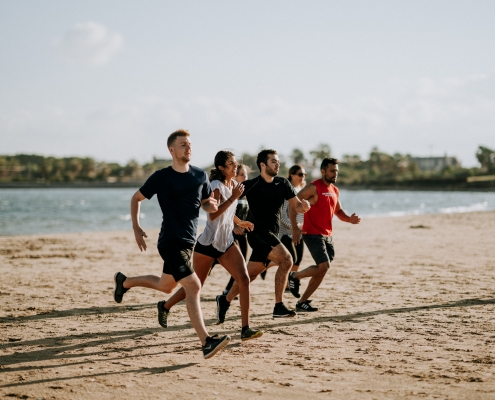 Group of runners training on the beach