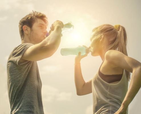 Sports couple drinking water after workout